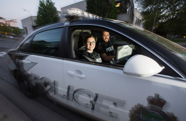 Carlye Myers, a mental health worker with the CMHA, rides with Const. Dan Dupuis of the Niagara Regional Police to assist with calls that involve people suffering from mental health issues. Julie Jocsak/ St. Catharines Standard/ Postmedia Network